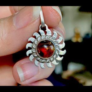 Genuine Amber set in a Sunburst Pendant 925 Silver